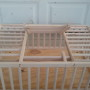 wooden chicken crate with solid floor.